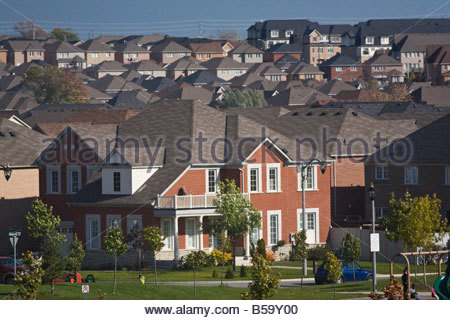 New housing creates suburban sprawl on former farmland in town of Ajax near Toronto in Southern Ontario Canada - Stock Photo