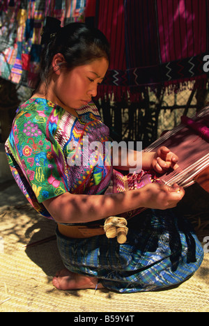 Local girl weaving, San  Antonio Aguas Calientes, Guatemala, Central America - Stock Photo