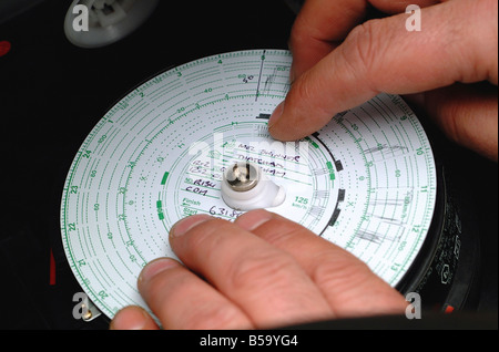 Close-up detail of lorry tachograph disc - the 'spy in the cab' - Stock Photo