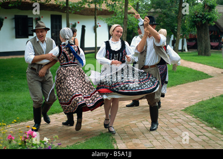 Folk dancing on horse farm in the Puszta, Hungary, Europe - Stock Photo