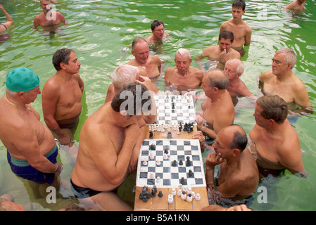 Bathers playing chess in the water at the Szechenyi Baths in Budapest Hungary Europe - Stock Photo