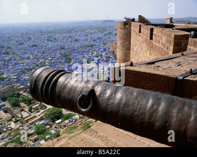Old cannon and view over Old City from Fort Jodhpur Rajasthan state India Asia - Stock Photo