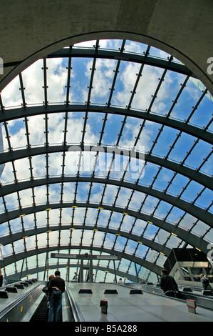 Underground station escalators, Canary Wharf, London, United Kingdom - Stock Photo