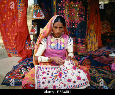 Woman doing embroidery, India - Stock Photo
