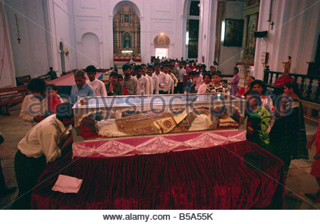 Pilgrims and the remains of St. Francis Xavier, Se Cathedral, Old Goa, India - Stock Photo