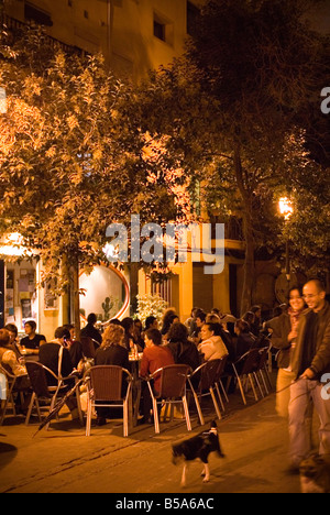 People sitting outside a busy local bar in the historic El Carmen city centre of Valencia Spain - Stock Photo
