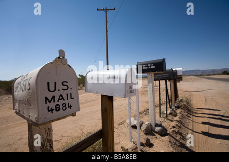 Row of US mailboxes on the roadside. - Stock Photo