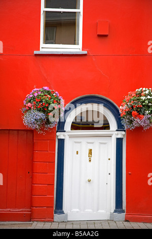 Red house in Fermoy Town, County Cork, Munster, Republic of Ireland, Europe - Stock Photo