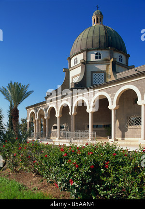 Red hibiscus in front of the Church on the Mount of Beatitudes, above the Sea of Galilee, Israel, Middle East - Stock Photo