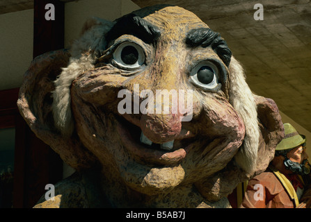 Giant wooden troll, typical of local craftsmanship, Sottoguda, Veneto, Dolomites, Italy, Europe - Stock Photo