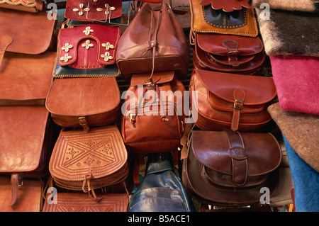 Leather goods on sale in souks Medina Marrakech Morocco North Africa Africa - Stock Photo
