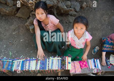 Hmong tribal village girls selling handicrafts, Luang Prabang, Laos, Indochina, Southeast Asia - Stock Photo