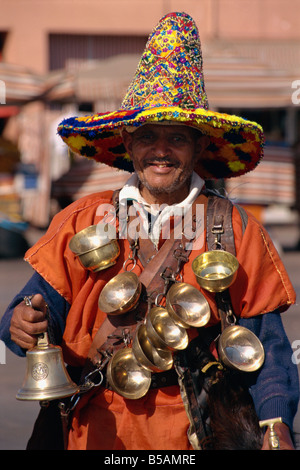 Waterseller on the Djemma el Fna, Marrakesh, North Africa, Africa - Stock Photo