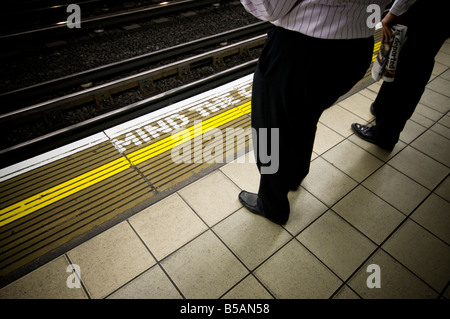 People waiting for train, London Unerground - Stock Photo