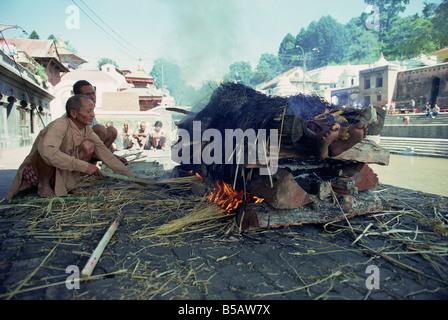 Hindu cremation Pashupatinath Temple Kathmandu Nepal Asia - Stock Photo
