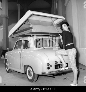 Inventions: Car Roof Tent: A new revolutionary camping invention 'The Roof Tent' seen here on top of a Austin A40. - Stock Photo
