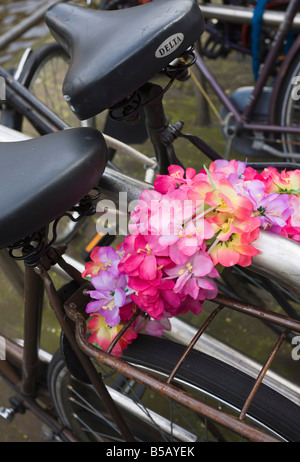 Old bicycles and flower chain, Amsterdam, Netherlands, Europe - Stock Photo