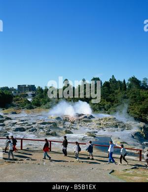 Tourists visiting the Whakarewarewa Thermal Reserve in Rotorua South Auckland North Island New Zealand Pacific - Stock Photo