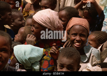 Smiling girl in crowd of children near Zinder Niger West Africa Africa - Stock Photo