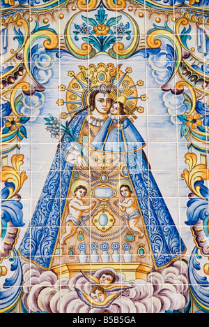 Hand painted glazed Azulejo tiles depicting the sacred statue and Patron Saint of the city of Valencia - Stock Photo