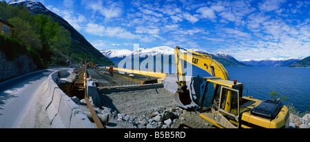Earth moving machinery used for widening Route 13 along Hardangerfjord in Hordaland, Norway, Scandinavia, Europe - Stock Photo