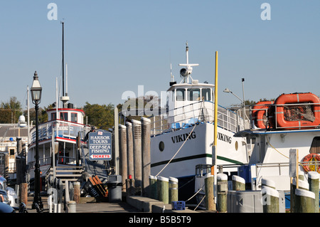 Harbor tour and deep sea fishing boats at dock in Hyannis Harbor, Cape Cod MA, USA - Stock Photo