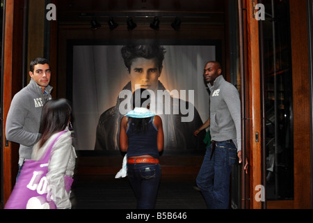 Shoppers entering Abercrombie on Fifth Avenue in New York City - Stock Photo