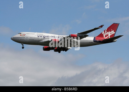 Virgin Atlantic Airways Boeing 747-400 airliner known as the jumbo jet flying on approach. Side view. - Stock Photo