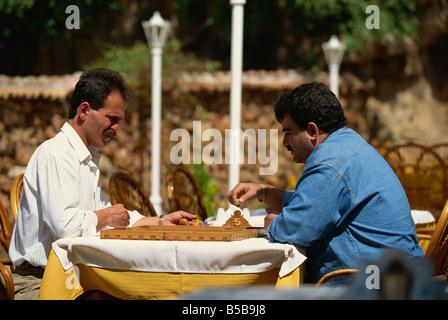Men playing checkers in the Kaleici (old town), Antalya, Anatolia, Turkey Minor, Eurasia - Stock Photo