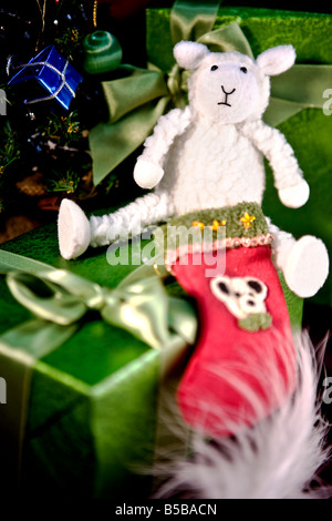 White Toy Sheep Wearing Christmas Stockings Sitting By The