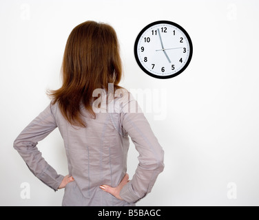 Businesswoman clock watching in office - Stock Photo