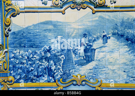 Azulejos showing harveting of port grapes, Pinhao railway station, Douro region, Portugal, Europe - Stock Photo