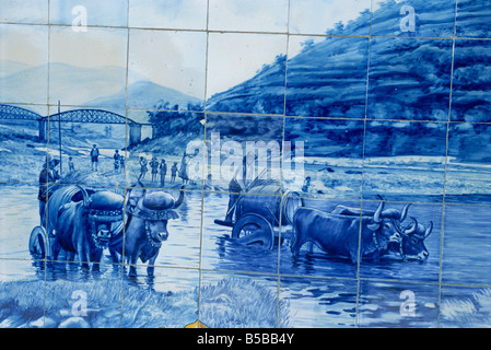 Azulejos showing port barrels on carts, Pinhao railway station, Douro region, Portugal, Europe - Stock Photo