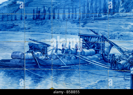 Azulejos showing port barges, Pinhao railway station, Douro region, Portugal, Europe - Stock Photo
