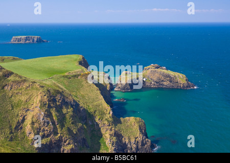 Carrick-a-rede rope bridge to Carrick Island, Larrybane Bay, Ballintoy, Ballycastle, County Antrim, Ulster, Northern - Stock Photo