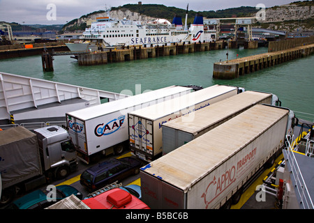 Lorries on deck of cross channel ferry approaching port of Dover England UK - Stock Photo
