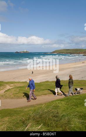 walking on the coastal footpath gwithian cornwall - Stock Photo