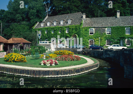 Swan Hotel on a bend in the River Coln, Bibury, Gloucestershire, The Cotswolds, England, Europe - Stock Photo