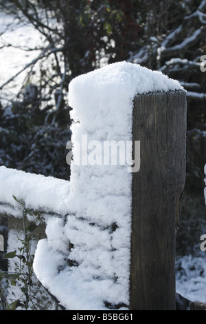 Gate post covered in snow - Stock Photo