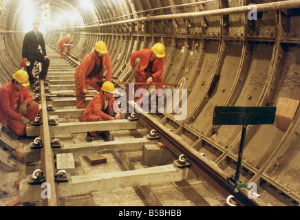 London Transport workers installing track in new tunnel loop Terminal 4 Heathrow London England United Kingdom Europe - Stock Photo