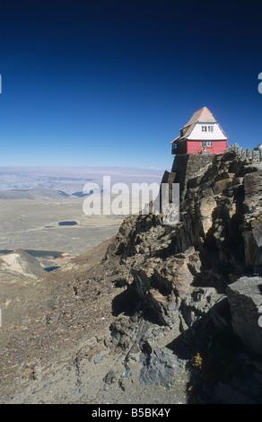 The old ski hut on Mt. Chacaltaya, altiplano in distance, Cordillera Real, Bolivia - Stock Photo