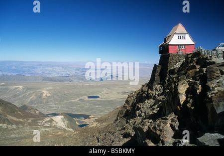 The old ski hut on Mt. Chacaltaya, altiplano in distance, near La Paz, Cordillera Real, Bolivia - Stock Photo