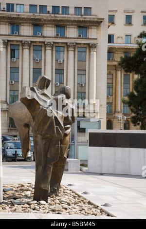 Bucharest Romania Revolution Monument and bronze statues in Revolution Square Piata Revolutiei with wall of names - Stock Photo