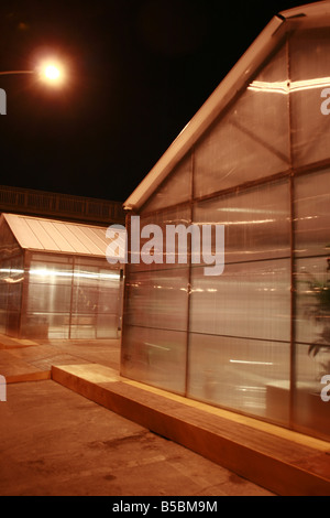 dark alley way at public event fair in city town at night - Stock Photo