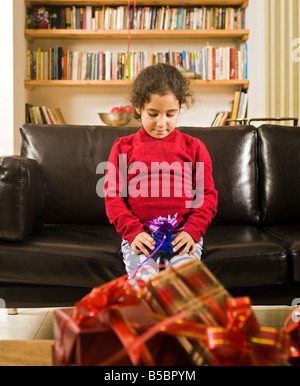 a little girl happy after reciving a present - Stock Photo