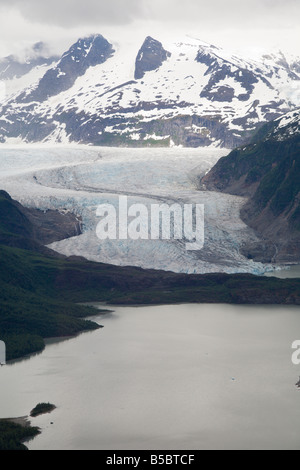 Mendenhall Glacier flows into Mendenhall Lake near Juneau, Alaska, USA - Stock Photo