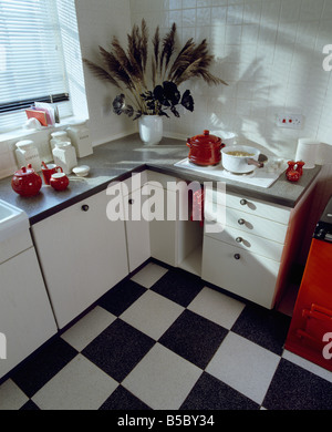 Black White Tiled Vinyl Floor In Fifties Kitchen With Red Worktops