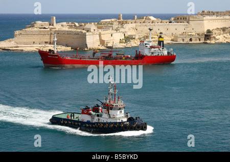 The 'Fuel Ship', 'Santa Elena' and Tug Boat in the Grand Harbour, Valletta, Malta. - Stock Photo