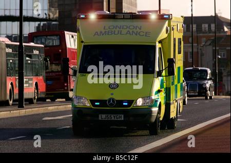 London Ambulance on emergency call - Stock Photo