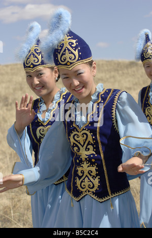 Young Kazakh Girls In Celebratory National Dresses - Stock Photo